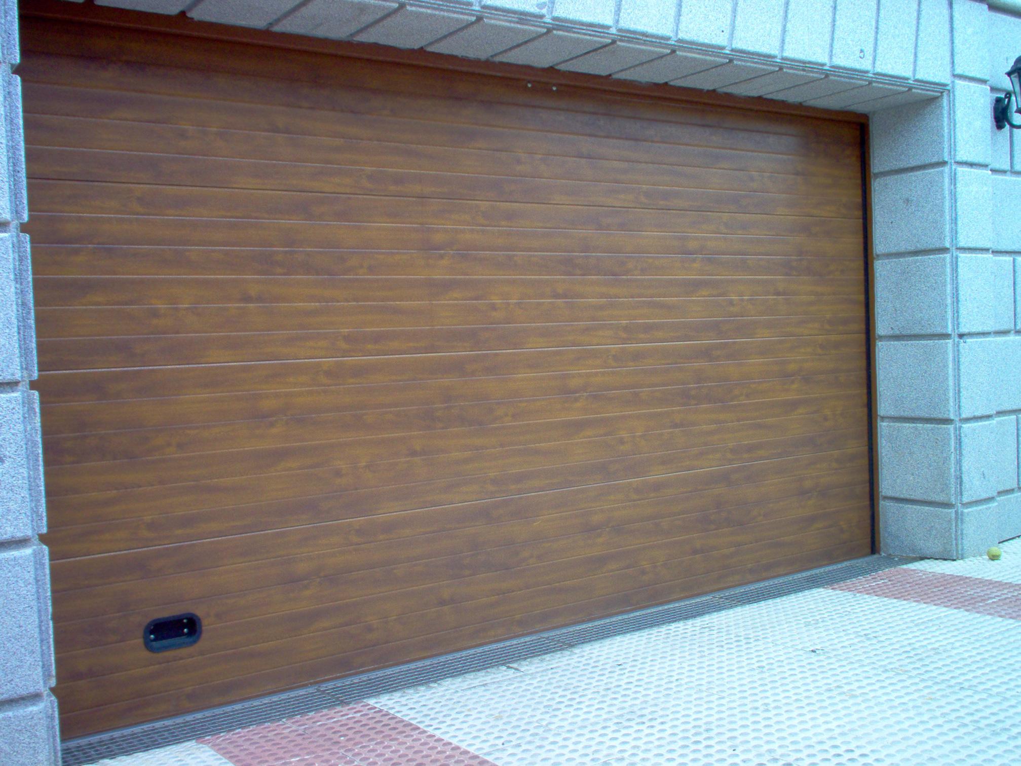 Puertas de garaje – automatismoycerrajería.es